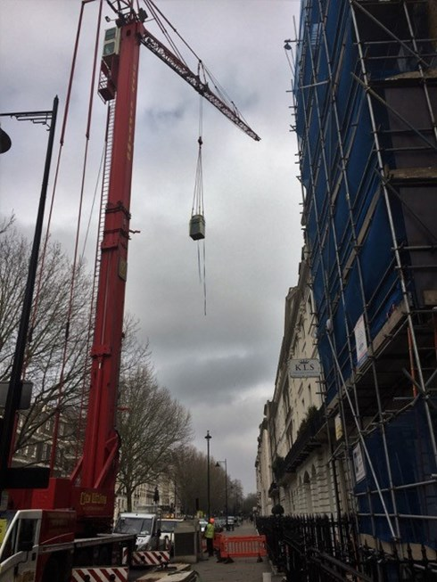 VRF Condensing unit being craned onto 42 Portland Place London