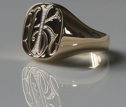 Mens signet ring with monogram