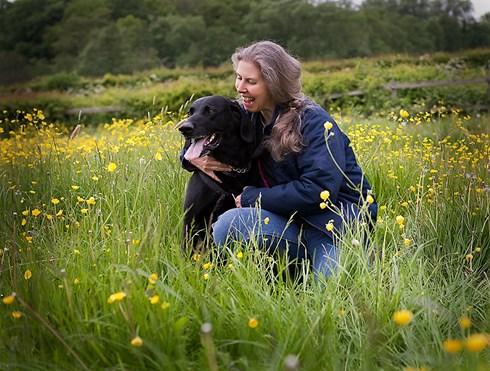 Karen Carpenter in field with dog