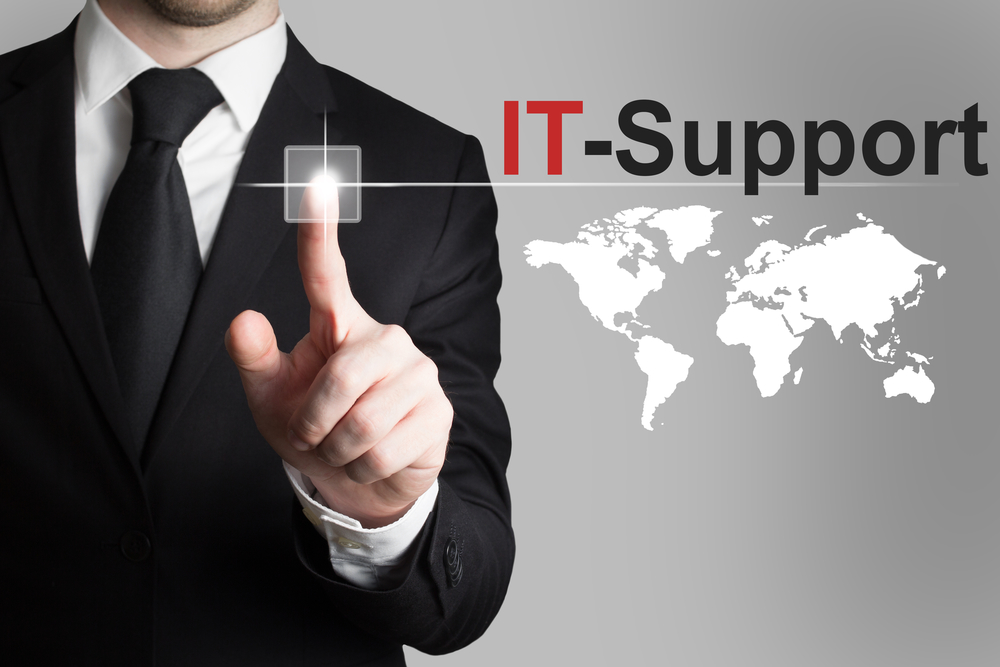 Businessman-pushing-button-it-support-worldmap