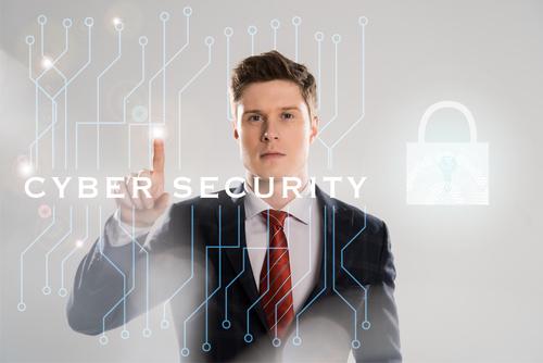 BusinessmanPointingToCyberSecuritySign