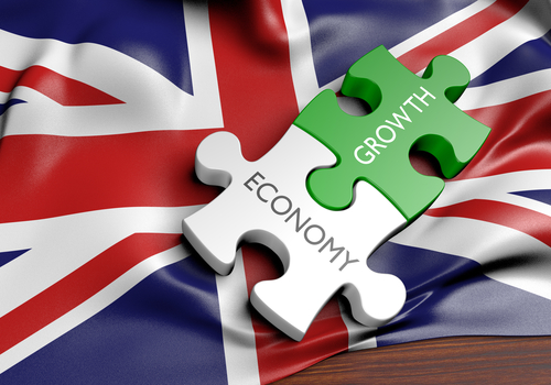 Economy and Growth jigsaw pieces over Union flag - small business productivity in the UK