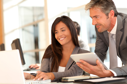 Man and woman in office working with computers