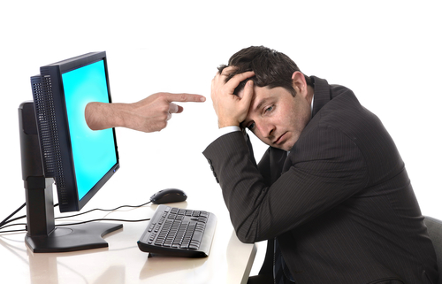 Stressed suited man in front of computer