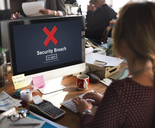 WomanWorkingAtComputerSecurityBreach