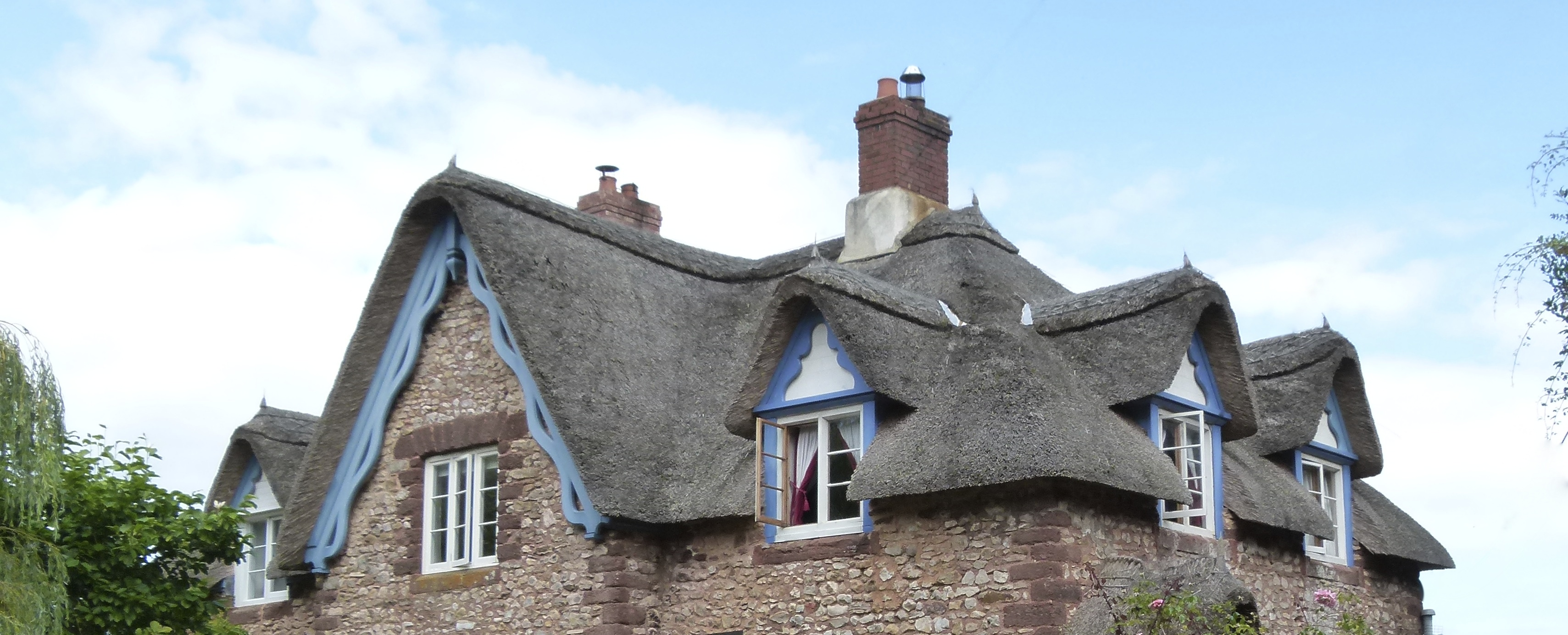 Thatch, dormers, replacement windows and barge boards all put back as original