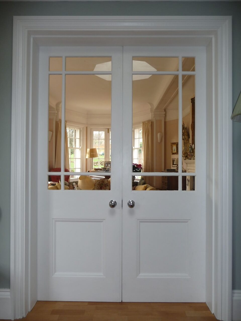 Bespoke French doors, frame and architraves.