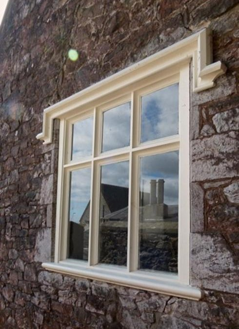 A new window made like for like, an exact copy of the original for a grade one starred listed building with a timber molded eyebrow.