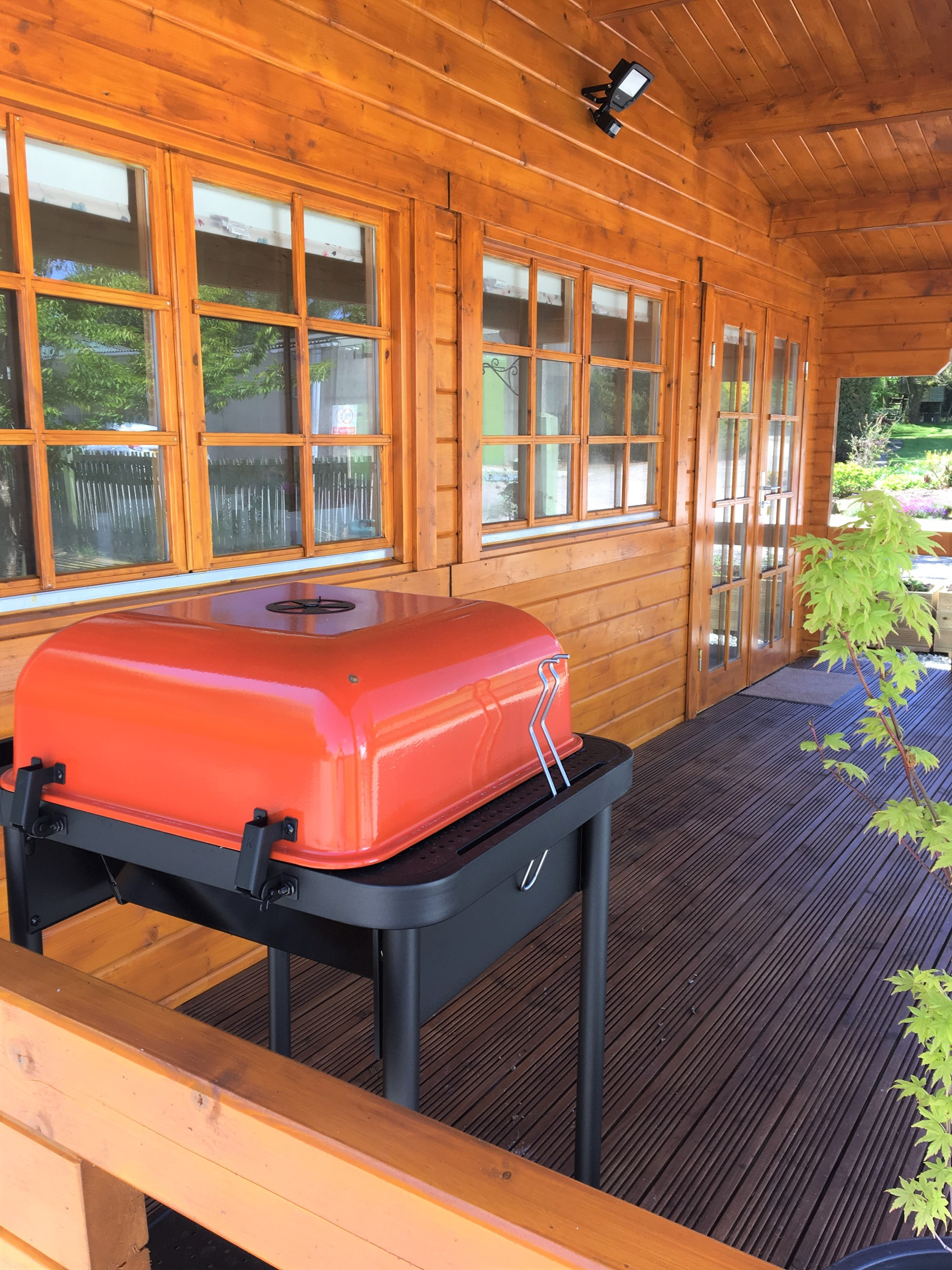 There is a barbeque and electric grill for outside use, and picnic tables