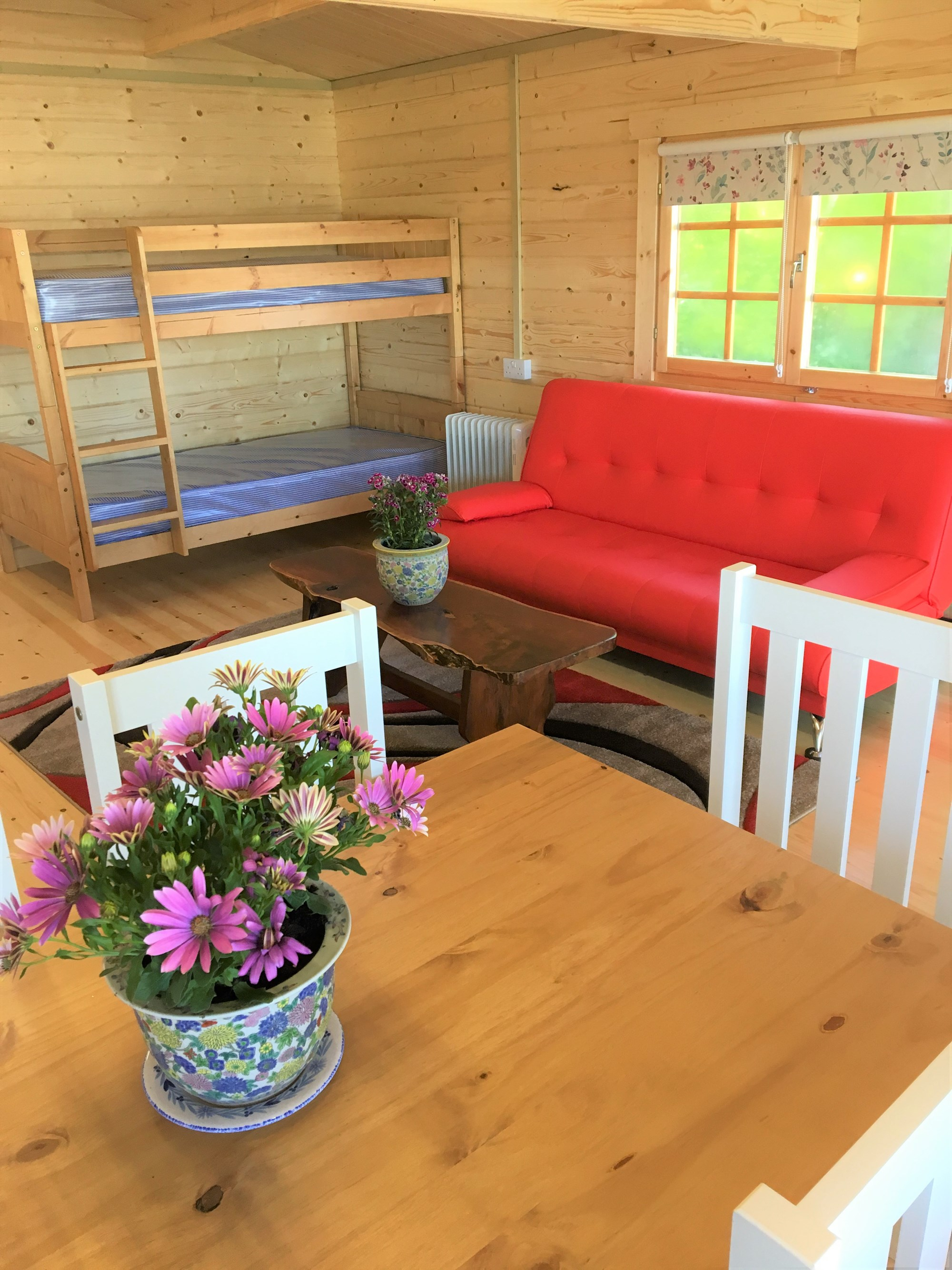 Inside Woodpecker-bunk beds, sofa bed, table and chairs for 6