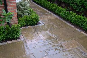 reclaimed yorkstone paving slabs with reclaimed granite setts