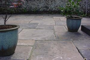 this picture shows the worn texture of these large reclaimed yorkstone paving slabs.