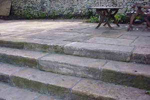 These reclaimed yorkstone kerbs do make fabulous steps.
