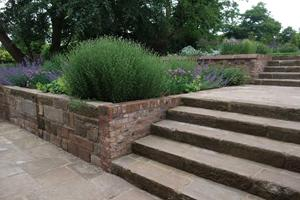 I find that wide reclaimed yorkstone steps add an air of grandeur to terraces