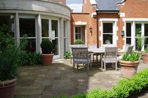 The photo of this terrace with random laid reclaimed york stone was taken some months after completion.