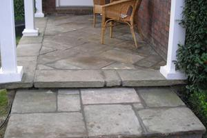 I particularly like the laying patten created in this entrance with reclaimed yorkstone slabs
