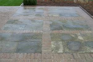 reclaimed York stone within a reclaimed brick grid
