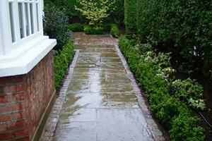 reclaimed york stone flagstones with a reclaimed granite sett border