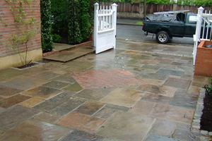 This picture shows the fabulous range of natural colour of reclaimed york stone paving slabs