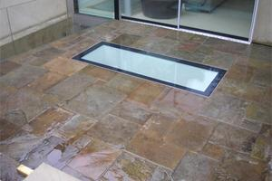 I like the contrast with a random patten reclaimed yorkstone patio in a contemporary design