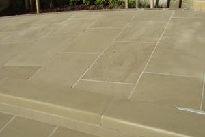 Radial yorkstone paving on a wheelchair accessible ramp.