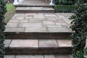 In this project reclaimed york stone paving is used for steps and the entrance