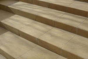 Solid Yorkstone yorkstone steps wit a rounded leading edge.