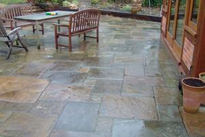 reclaimed york stone paving laid in a random pattern