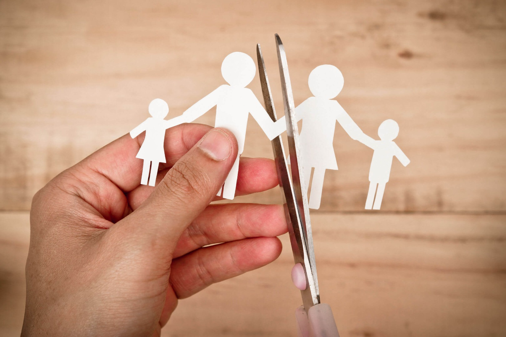 cutting paper family with scissors