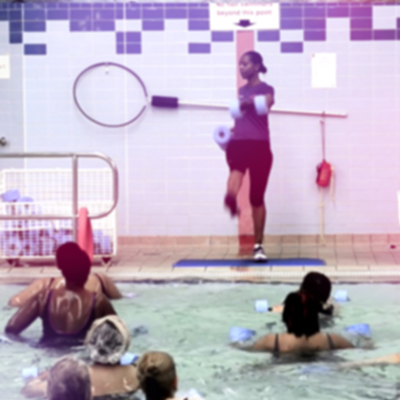 Ladies in pool in aqua fit exercise class