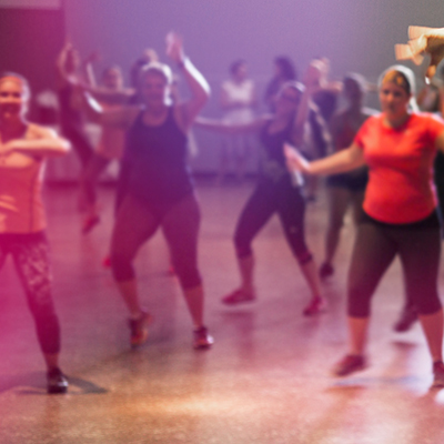 Mature ladies exercising in mature movers class