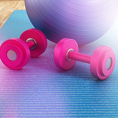 Exercise ball with weights on yoga mat
