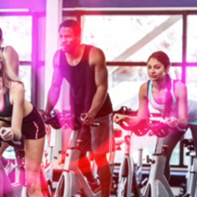 People exercising on Cycling machines in Newham leisure centre