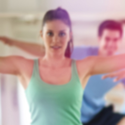 people exercising in gym tone session