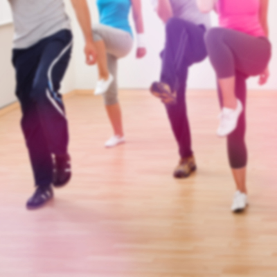 People exercising in step and tone class