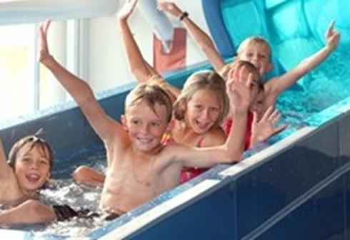 Children on a water slide
