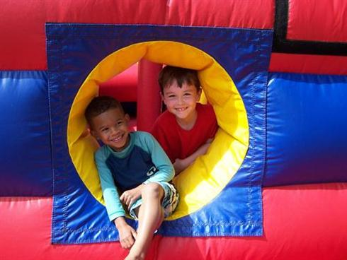 Toddlers playing in a soft play area