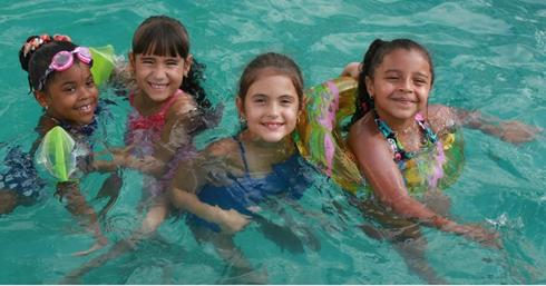 Young children at a swimming pool party