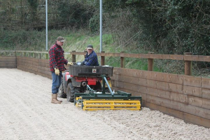 Arena leveller being towed behind a quad bike on a waxed surface