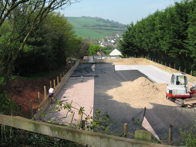Geomembrane being installed prior to surface being laid