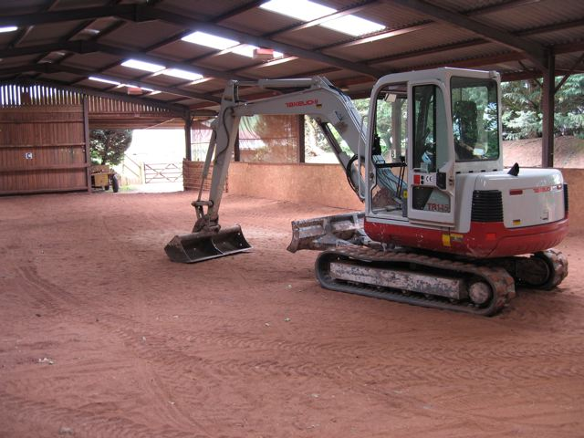 Indoor riding arena formation being levelled
