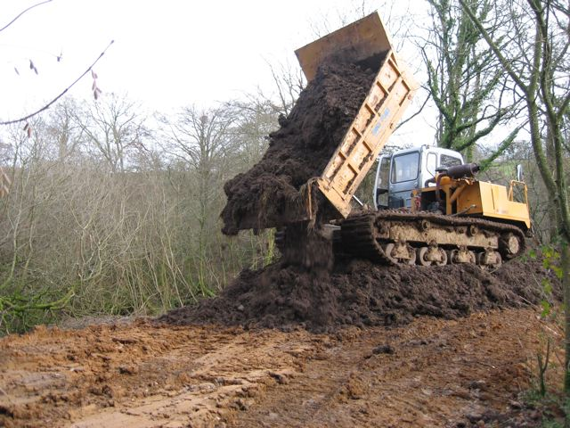 Tracked dumpers used for topsoiling on soft ground conditions