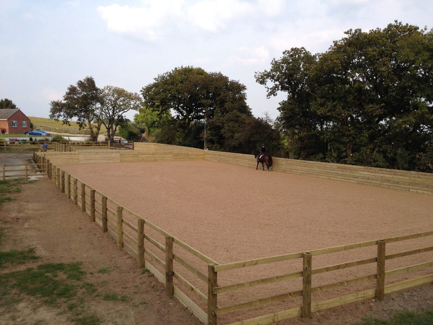 Outdoor riding arena refurbishment with a waxed surface in Devon