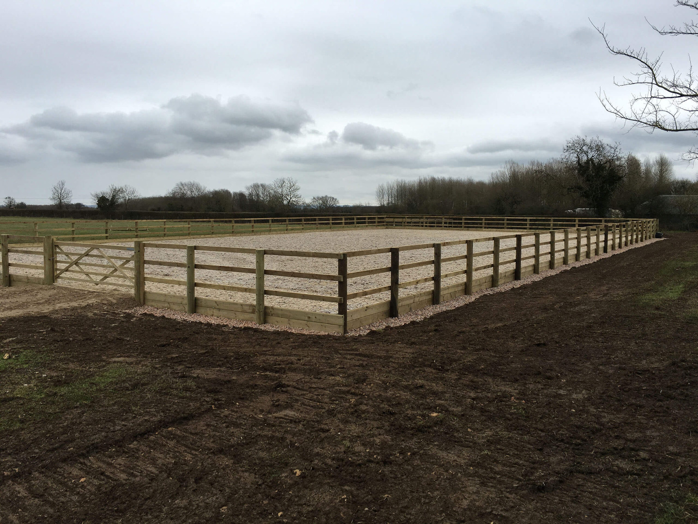 Sand and Fibre surface installed on a 25m x 45m riding arena in Wiltshire