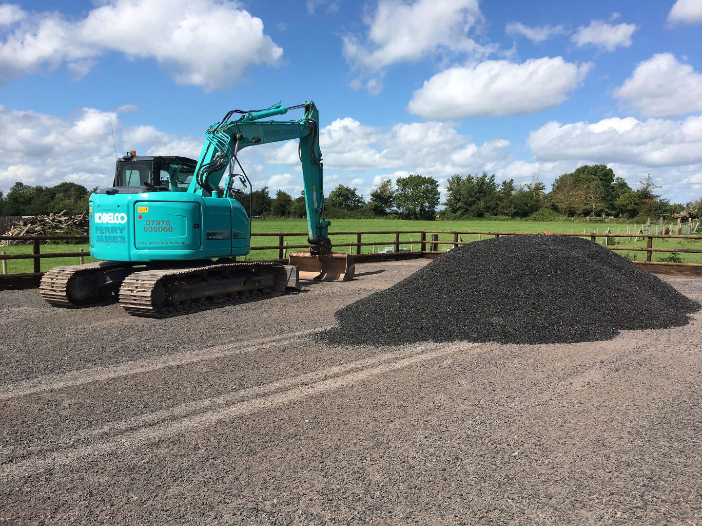 Rubber chippings delivered on a riding arena ready for levelling