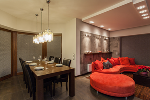 Installed hanging lights, skylights and wall lights to a lounge and dining area