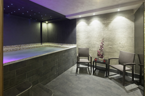 Indoor pool and lounge area ceiling and wall lighting installation