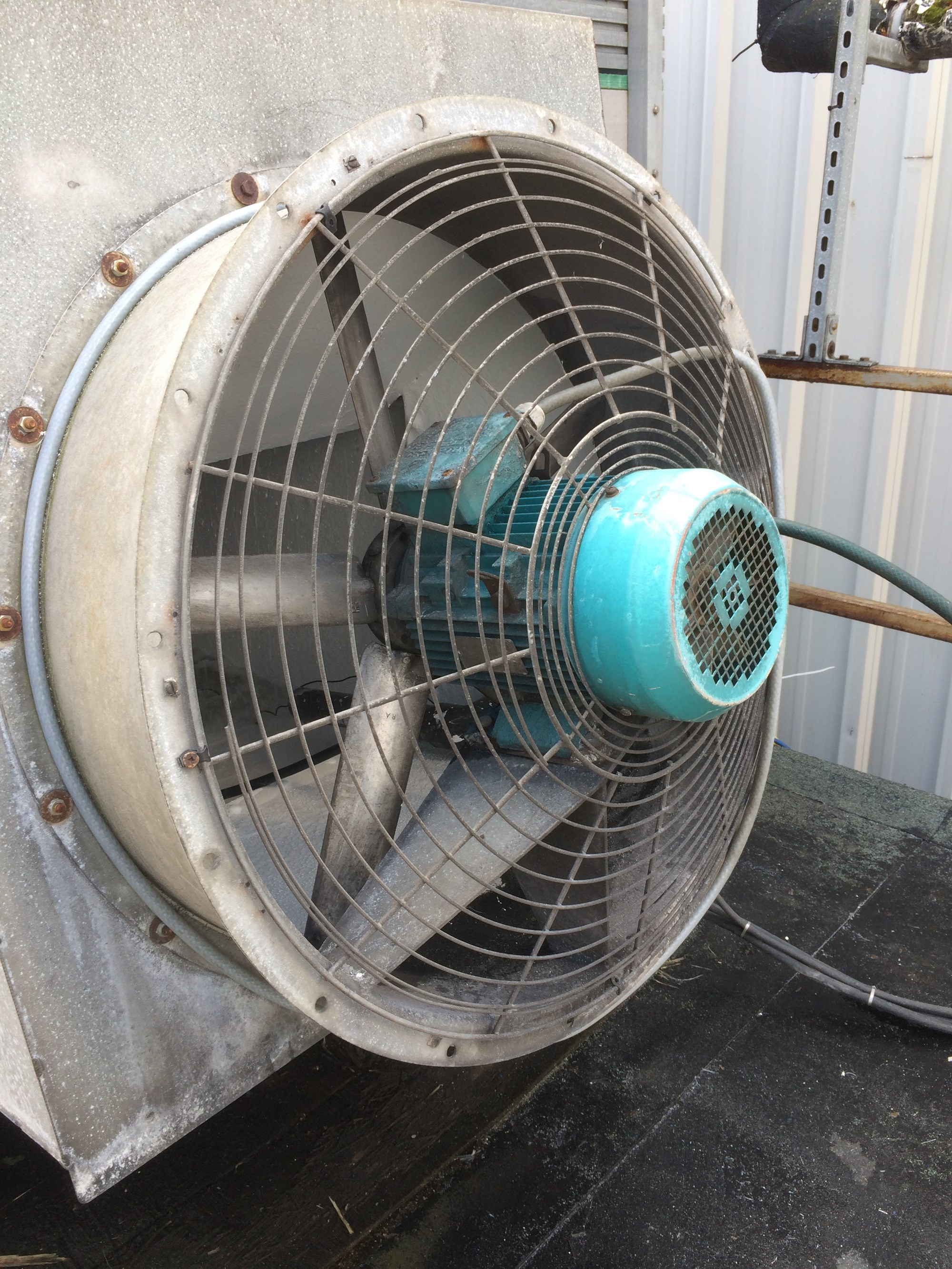Elta Fan cooling tower inlet with mesh guard and extended motor cowl.