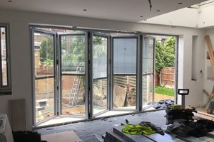 By fold door in stamford hill