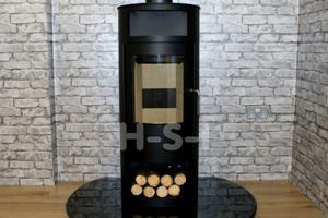 We can supply hearths, pictured is a highly polished smooth granite hearth - please call to discuss options.  A flat backed circular hearth perfect for the rounded stove.
